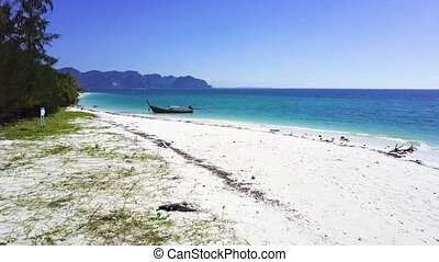 Long-tail boat on a beautiful beach at island in Krabi...