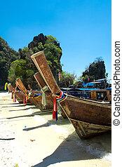 Long tail boat on tropical beach , Krabi, Thailand