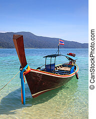 long tail boat sit on the beach, Ra