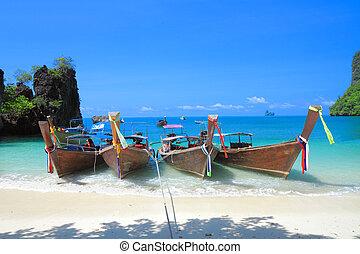 Long tail boats on tropical beach at koh Hong island, Andaman sea of Thailand