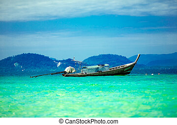 Long tailed boat in tropical waters of Thailand