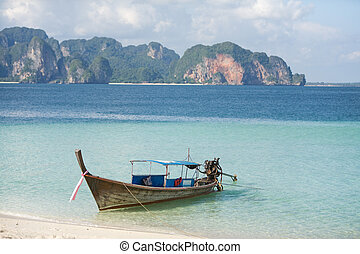 Long tailed boat - Thai long tailed boat in light blue ocean