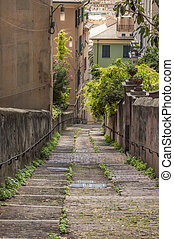 Long tight alley on the hills of Genoa city