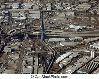 Long train runs though LA aerial view