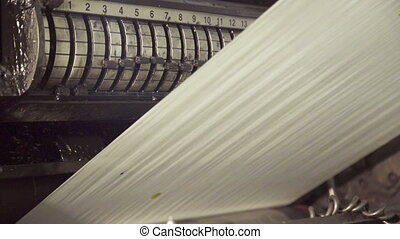 Long uncut clear paper on rolling machine, moving up