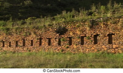 Long Wall Made of Stone - Handheld, panning shot of a long...