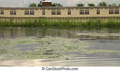 Long waterfront building upon a marshy lake - Dolly shot...