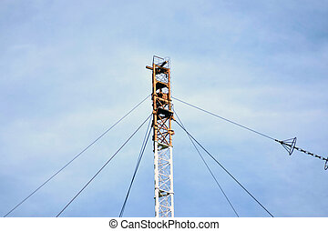 Long-wave radio-transmitting towers. Telecommunication tower with steel ladder