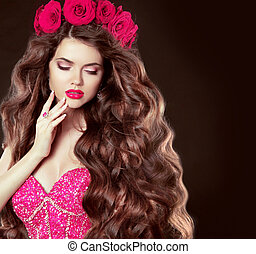 Long wavy hair. Beautiful brunette girl with sensual lips, in gl