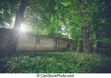 Long weathered brick wall