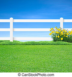 Long white fence and yellow flowers