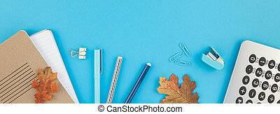 Creative flat lay top view back to school concept with color school and office supplies on bright turquoise paper table frame background with copy space, template for text or design. Long wide banner