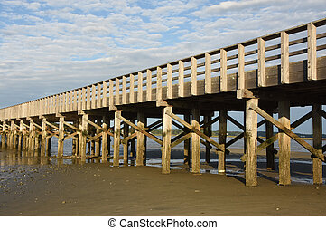 Long Wood Bridge Stretching Over a Bay at the Beach
