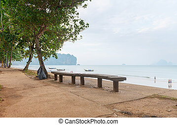 Long wooden bench by the seaside