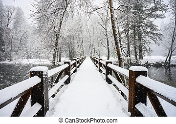 Long Wooden Bridge Covered in Snow