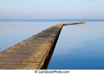 long wooden pier on big lake