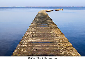 long wooden pier on lake