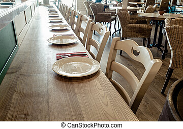 wooden table decorated with dishware