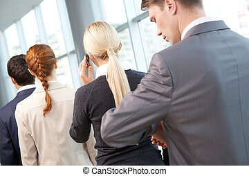Long working hours - Row of people with businesswoman ...