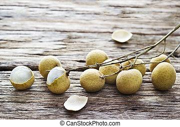 longan. fresh longan on wooden background