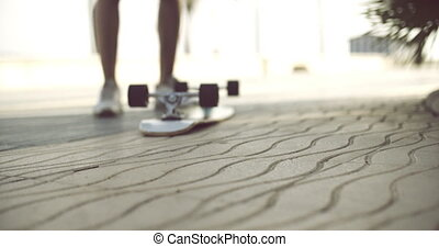 longboard in upside down on a concrete ground skater man