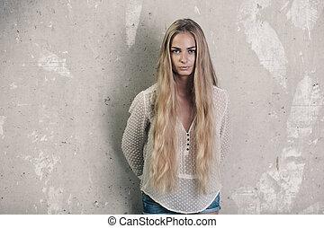 Longhaired blond girl - Longhaired girl over grunge wall