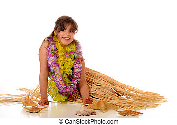 A happy elementary girl relaxing in her grass skirt and leis. Isolated on white.