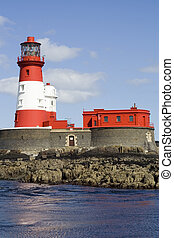 Red and white lighthouse tower that was home to the famous Northumbrian heroine Grace Darling.