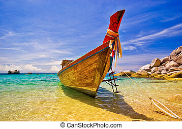 Longtail Boat Anchored in idyllic settings