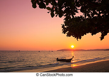 Longtail boat in Andaman sea at sunset, Thailand