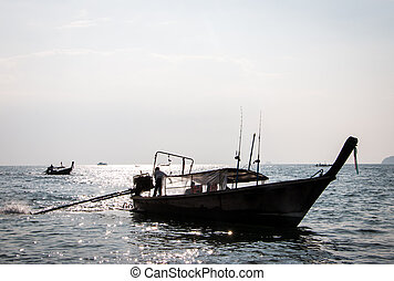 Longtail Boat In Phuket Thailand At Sunset