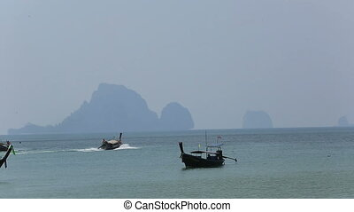 longtail boat sailing on sea,thaila