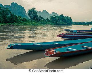 longtail boats at Song river, Vang Vieng, Laos