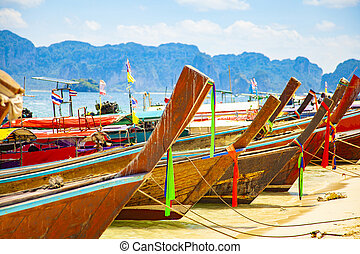 Longtail boats on tropical beach in Thailand