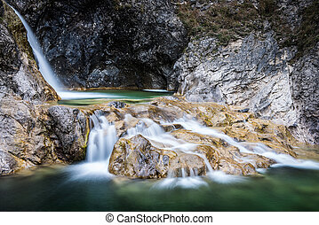 Longtime Exposure of water pools in rocks with green flowing...