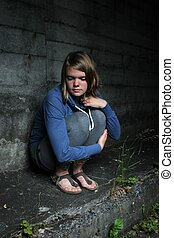 lonly girl on a wall