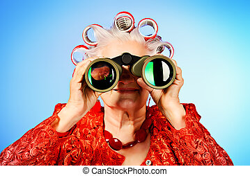 look ahead - Portrait of an elderly woman in curlers looking...