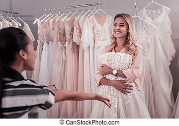 Joyful beautiful woman smiling to her friend - Look at me....