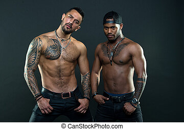 Look at the tattoo we got. Muscular men with fashionable tattoo style. Sexy men with muscular torso. Brutal macho style. Strong men are sexy
