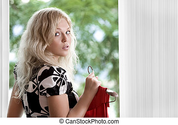 look back - Portrait of young nice woman with dress on color...