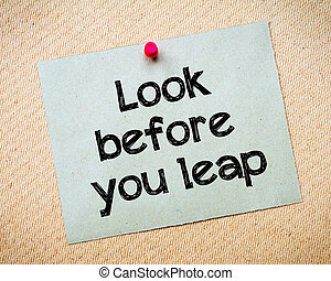 look Before You Leap Message. Recycled paper note pinned on...