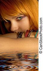 look - dark portrait of lovely redhead in water