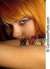 look - dark portrait of lovely redhead