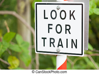 Look for train warning sign black lettering on white...