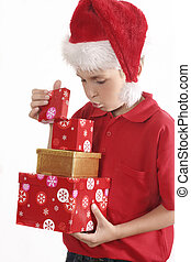 Look Inside - A child llifts the lid and looks inside a box.