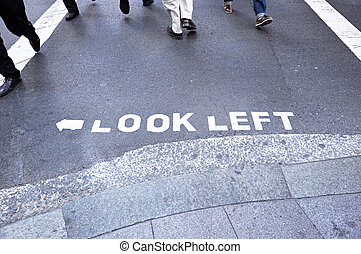 LOOK LEFT sign on the street