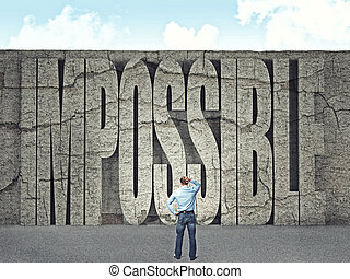 man look huge wall with impossible text