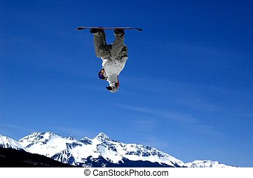 look ma no land - snowboarder inverted above snow covered...
