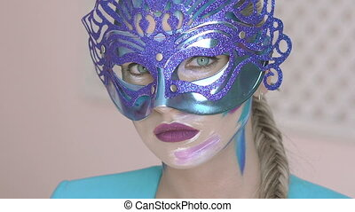 Look of the mysterious girl in venetian mask with winter art makeup
