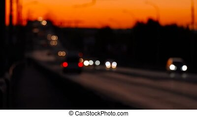 Look over the overpass with defocused cars, sunset - Look...